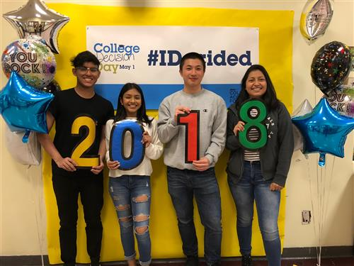 College Decision Day #IDecided, four students holding up each digit for year 2018