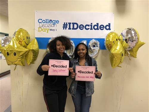 College Decision Day #IDecided, Janiya and another student holding up signs